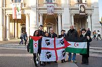 Roma 2 Marzo 2012.Esposta in Campidoglio la foto di Rossella Urru,la cooperante di 29 anni rapita da oltre quattro mesi in un campo profughi saharawi a Tindouf  nel sud dell'Algeria in un campo profughi Saharawi, assieme ad altri due volontari spagnoli. per mano di  terroristi..La bandiera della Sardegna e  la bandiera saharawi per Rossella