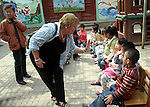 Travcoa Travel Director Jane Vermeulen hosts visit to Chinese kindergarten class.