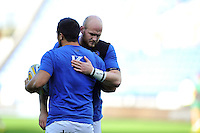 Matt Garvey of Bath Rugby with team-mate Leroy Houston during the pre-match warm-up. Aviva Premiership match, between London Irish and Bath Rugby on November 7, 2015 at the Madejski Stadium in Reading, England. Photo by: Patrick Khachfe / Onside Images