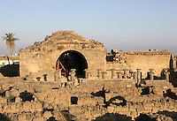 Ruined buildings and Ionic peristyle, Roman baths, 3rd century AD, Bosra, Syria Picture by Manuel Cohen