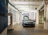 A Tesla Model S sits alone in the Tesla showroom in New York on Tuesday, October 20, 2015. Consumer Reports has dropped its recommendation of Tesla citing complaints by owners including replacement of motors, defective door handles and miscellaneous squeaking noises. (© Richard B. Levine)