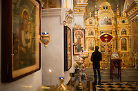 A man worships in the Cathedral of the Nativity of the Blessed Virgin Mary in Ufa, Bashkortostan, Russia.