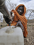 A woman gets water in the Hassa Hissa Camp for internally displaced persons, outside Zalingei in Sudan's violence-torn Darfur region. ACT-Caritas is providing water and a variety of other services in this camp.