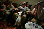 Marine Lt. Col. Craig Kozeniesky - battalion commander for 2nd Battalion 5th Marines (2/5) - and several of his officers and Marines meets with Sheik Shahoud Asi at his home in central Ramadi for an evening of food and cigars on Tuesday May 22, 2007. In recent weeks, Ramadi, the provincial capital of the turbulent al-Anbar province has turned from one of the most deadly places in Iraq into an island of relative stability as tribal leaders there have split from the insurgency after years of killings and intimidation. US forces have been quick to step in to the breach and offer friendship and assistance to the sheiks and their followers.