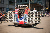 """A """"boombox"""" car in the Dominican Day Parade in New York on Sixth Avenue on Sunday, August 11, 2013.  Politicians, flags and cultural pride were on display at the annual event.  (© Richard B. Levine)"""