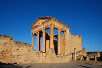 Low angle view of the Roman Capitol, 2nd century, in Dougga, Tunisia, pictured on January 31, 2008, in the morning. Dougga has been occupied since the 2nd Millennium BC, well before the Phoenicians arrived in Tunisia. It was ruled by Carthage from the 4th century BC, then by Numidians, who called it Thugga and finally taken over by the Romans in the 2nd century. Situated in the north of Tunisia, the site became a UNESCO World Heritage Site in 1997. This is one of the best preserved Roman temples in North Africa with a portico of six Corinthian columns. Picture by Manuel Cohen.