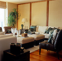 Seagrass, leather and linen-covered furniture in neutral tones create a restful and elegant living room