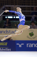 October 19, 2001; Madrid, Spain:  AURELIE LACOUR of France performs stag leap with rope at 2001 World Championships at Madrid.