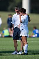 Virginia head coach Steve Swanson talks to Molly Menchel (13) after the game at Klockner Stadium in Charlottesville, VA.  Virginia defeated Duke, 1-0.