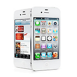 Two white iPhone 4s Apple smartphones one displaying desktop another holday offers at iTunes store. Isolated on white background with clipping path.
