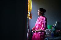 Portrait of Ana Karen Cruz Casiano 18 years old in the kitchen of her home in the Mazahua indigenous community near San Felipe del Progreso, in the Estado de mexico, Mexico