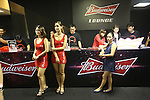 ONE VIP area during fight. Red dressed girls front an event sponsored by budweiser<br />