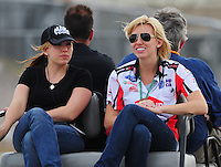 Apr. 2, 2011; Las Vegas, NV, USA: NHRA funny car driver Courtney Force (right) sits with sister Brittany Force during qualifying for the Summitracing.com Nationals at The Strip in Las Vegas. Mandatory Credit: Mark J. Rebilas-