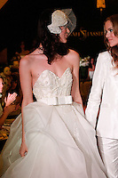 Models walk the runway in a Celestial wedding dress and Regal wedding outfit by Sarah Jassir, at the close of the Sarah Jassir Couture Bridal Fall 2012 Opulence collection, dedicated to Marriage Equality.