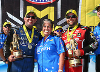 Jun 19, 2016; Bristol, TN, USA; NHRA funny car driver Tommy Johnson Jr (left) celebrates with sponsor Terry Chandler (center) and top fuel driver Shawn Langdon after winning the Thunder Valley Nationals at Bristol Dragway. Mandatory Credit: Mark J. Rebilas-USA TODAY Sports