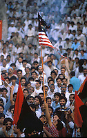 Pakistan Lahore  1986..Supporters of the Pakistan People Party at a demonstration against  U.S. burn a US flag..