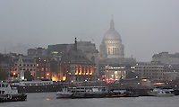 St Paul's Cathedral in the mist at night, 1675-1710, by architect Sir Christopher Wren, London, UK. Picture by Manuel Cohen