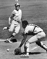 Oakland Athletics Joe Rudi scores on Washington Senators catcher Paul Casanova in the first game of Double-Header in Oakland. (1971 photo by Ron Riesterer)
