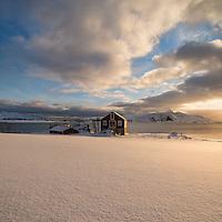Barn in coastal winter landscape, Vestvågøy, Lofoten Islands, Norway