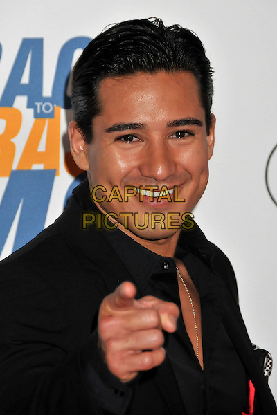 """MARIO LOPEZ .16th Annual Race To Erase MS Themed """"Rock To Erase MS"""" held at the Hyatt Regency Century Plaza, Century City, CA, USA..May 8th, 2009.headshot portrait black hand pointing .CAP/ADM/BP.©Byron Purvis/AdMedia/Capital Pictures."""