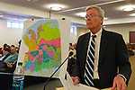 Feb. 25, 2013 - Mineola, New York, U.S. - FRANCIS X. MORONEY, Chairman of the Temporary Redistricting Advisory Commission, discusses the controversial proposed Redistricting Map at the Nassau County Legislature meeting. The legislature postponed the vote on the map shortly before 1 AM the morning of February 26, nearly 12 hours after the meeting started on 1:30 PM Feb. 25. Over 100 members of the public submitted Speakers Forms, and the meeting was so well attended that some visitors had to stand in the chambers or watch in other rooms of the legislative building.