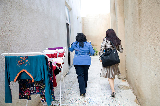 SULAIMANIA, IRAQ: Rezan meets once weekly with women inmates of a local jail, offering her services pro bono for women in need of representation.  This day, she took on two new cases.
