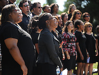 STAFF PHOTO ANDY SHUPE - Members of the choir perform during a dedication ceremony Sunday, Sept. 21, 2014, for the Gehring Cemetery at Christian Life Cathedral in Fayetteville.