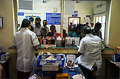Patients wait to get the medicines and treatment oil from the dispensary at the OPD of the National Research Institute of Panchakarma in Cheruthuruthy in Thissur district of Kerala, India.