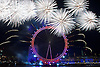 London New Year&rsquo;s Eve 2014 fireworks display viewed from The RAF Memorial on Victoria Embankment opposite the London Eye, central London <br /> 31st December 2014 <br /> Since first being staged at the London Eye on the South Bank in 2003, the numbers of people heading to see the acclaimed pyrotechnic and lighting display have mushroomed from an estimated 100,000 people in its first year to an estimated 500,000 last year (2013). Last year around half a million people are estimated to have attended. <br /> <br /> The London New Year's Eve fireworks display was produced by London based Jack Morton Worldwide for the 11th consecutive year. Jack Morton is a global brand experience agency.<br /> <br /> <br /> Photograph by Elliott Franks <br /> Image licensed to Elliott Franks Photography Services