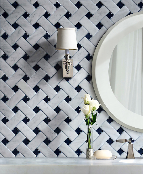 Fraser, a stone waterjet mosaic, shown in Carrara Venetian honed and Deep Ultramarine glass flowers with honed Deep Ultramarine glass bricks, is part of the Altimetry Collection for New Ravenna.