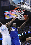North Carolina Tar Heels forward Desmond Hubert (14) attempts to block Kentucky Wildcats forward Julius Randle (30) from shooting a layup during the UK men's basketball vs. North Carolina at the Dean Smith Center in Chapel Hill, N.C., on Saturday, December 14, 2013. Photo by Emily Wuetcher | Staff