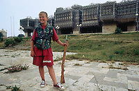 Kosovo. Pristina. A young serb boy, wearing shorts and t-shirts, stands in front of the library, which is an interesting structure with white domes and a decorative iron grate on the outside walls. The kid holds a toy rifle in his hand and wears military outfitts like a soldier. War game. Kosovo (Albanian: Kosova) is a province of Serbia. While Serbia's sovereignty is recognised by the international community, in practice Serbian governance in the Kosovo province is virtually non-existent.  &copy; 1995 Didier Ruef