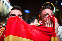 Two fans moments before the goal of Spain