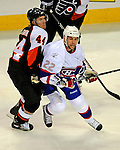 15 November 2008:  Montreal Canadiens' left wing forward Steve Begin is checked by Philadelphia Flyers' defenseman Kimmo Timonen rom Finland in the second period at the Bell Centre in Montreal, Quebec, Canada.  The Canadiens, celebrating their 100th season, fell to the visiting Flyers 2-1. ***Editorial Sales Only***..Mandatory Photo Credit: Ed Wolfstein Photo *** Editorial Sales through Icon Sports Media *** www.iconsportsmedia.com
