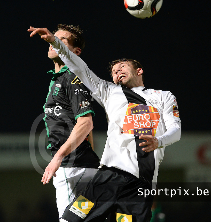 20161217 - ROESELARE , BELGIUM : Roeselare's Lukas Van Eenoo pictured in a duel with Cercle's Karel Van Roose (left) during the Proximus League match of D1B between Roeselare and Cercle Brugge, in Roeselare, on Saturday 17 December 2016, on the day 20 of the Belgian soccer championship, division 1B. . SPORTPIX.BE | DAVID CATRY
