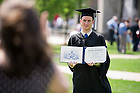 May 22, 2011; A graduate poses for photos with his diploma, Commencement 2011...Photo by Matt Cashore/University of Notre Dame