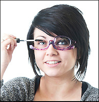 BNPS.co.uk (01202 558833)<br /> Pic: LauraJones/BNPS<br /> <br /> Thats a good eye-dea...<br /> <br /> Short-sighted women now have the opportunity to stop squinting in front of the mirror when applying make-up - thanks to a new pair of special glasses.<br /> <br /> The clever contraption could put an end to smudged eyeliner, badly applied eyeshadow, and messy mascara for good.<br /> <br /> The quirky invention, dubbed the Make-Up Glasses, look the same as a pair of normal spectacles however they only have one lens.<br /> <br /> When applying cosmetics to one eye, a user can easily peer through the lens instead of wearing none at all and struggling with blurred vision.<br /> <br /> Once finished, the entire lens will flip onto the other side of the frames thanks to a special hinge and will work on the second eye.<br /> <br /> The glasses come in a reading strength of plus 1.50, 2.00, 2.50 and 3.00 and are sold by spectacles company Peepers.