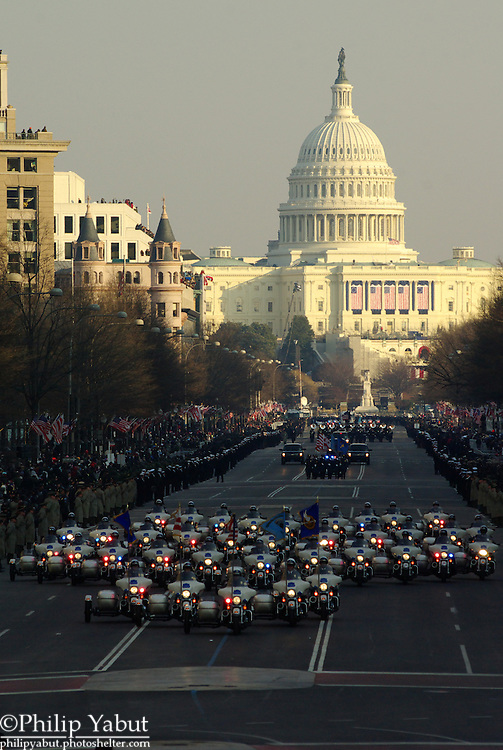 A phalanx of police motorcycles heralds the start of President Barack Obama's Inaugural Parade.
