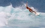 A surfer at Ehukai Beach (Banzai Pipeline) on the Northshore of Oahu, Hawaii.