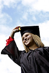 A young woman graduating with a diploma certificate
