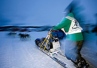 The Finnmarksløpet 2007, 10th - 17th March. At 1000km, this is the longest and northernmost dog sledging race in Europe. .4th placed contestant Ralph Johannessen, leaves the check point of Joatka.
