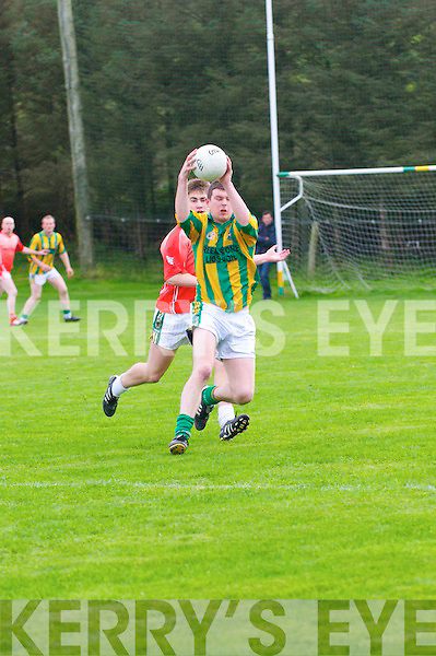Lispole Declan O'Sullivan in possession of the ball closely watched by Brosnan Eamon Kiely during the County League Div. 4 match in Lispole on Saturday evening...