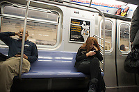 An advertisement in a New York City subway car advises consumers to cut out eating junk food, seen on Friday, October 26, 2012. (© Richard B. Levine)