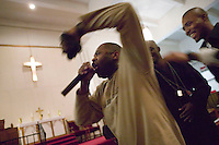 New York, USA - Reverend Stephen Pogue (L) preaches followed by members of the Hip-Hop Choir during mass at the Greater Hood Memorial AME Zion Church, home of the Hip-Hop Church, in Harlem, New York, USA, 20 January 2005.. Photo Credit: David Brabyn.