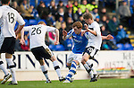 St Johnstone v Dundee.....02.01.13      SPL.Liam Craig is tackled by Brian Easton and Jim McAlister.Picture by Graeme Hart..Copyright Perthshire Picture Agency.Tel: 01738 623350  Mobile: 07990 594431