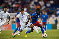 Honduras forward Mario Martinez (10) goes for a tackle of Haiti forward Leonel Saint Preux (18). Honduras defeated Haiti 2-0 during a CONCACAF Gold Cup group B match at Red Bull Arena in Harrison, NJ, on July 8, 2013.