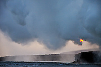 Steam rising off lava flowing into ocean at sunset, Kilauea Volcano, Hawaii Islands, United States