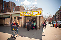 Customers line up outside the Pickle Guys store in the Lower East Side of New York on Sunday, April 2, 2017 to buy freshly ground horseradish and pickles for Passover. Everyone from millennials to former Lower East Sider's descend on the store to buy the freshly ground pungent horseradish to enjoy and to use in Passover seders. The bitter herb brings tears to our eyes and reminds us of the tribulations afflicted on the Jewish people in their flight from Egypt. Passover begins the evening of April 10.  (© Richard B. Levine)
