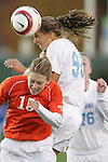 3 November 2006: North Carolina's Tobin Heath (98) heads the ball over Clemson's Julie Bolt (15). North Carolina defeated Clemson 3-0 at SAS Soccer Park in Cary, North Carolina in an Atlantic Coast Conference women's college soccer tournament semifinal game.