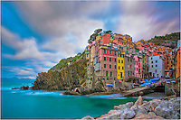 Early in the morning in this small Italian village of Riomaggiore, I awoke before sunrise and captured the fast moving clouds. This is one of my favorite pictures of the Cinque Terre, filled with color and life. In the small village, the only sounds I could hear were locals preparing for the morning, and the air was filled with the taste of salt and the wonder smells of a bakery just up the main street...I've had the opportunity to visit this wonderful place in Italy many times, and always look forward to my next visit.